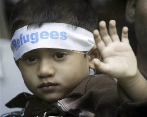 A Refugee young boy took part in a peaceful Assembly with his parents infront of UNHCR for their dur-rights